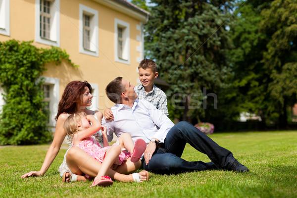 Család ül otthon fiatal boldog család nap Stock fotó © Kzenon