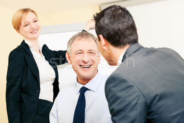Business team discussing pleasant things Stock photo © Kzenon