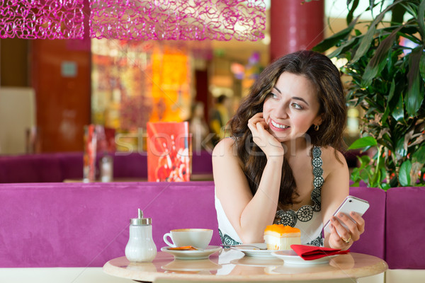 Young woman in ice cream parlor Stock photo © Kzenon