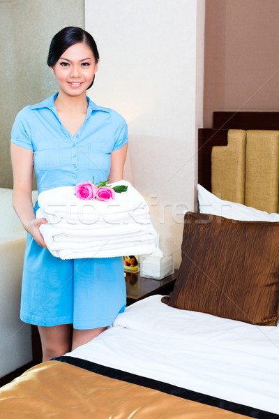 Chambermaid cleaning in Asian hotel room Stock photo © Kzenon