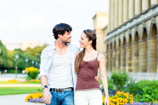 Tourist couple in city walking Stock photo © Kzenon