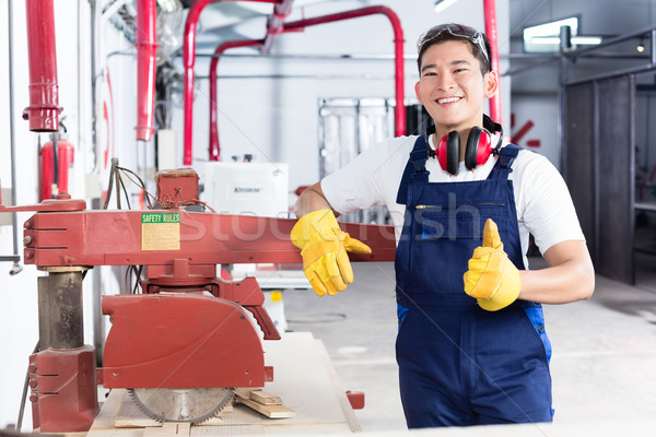 Proud Asian carpenter showing thumbs up Stock photo © Kzenon
