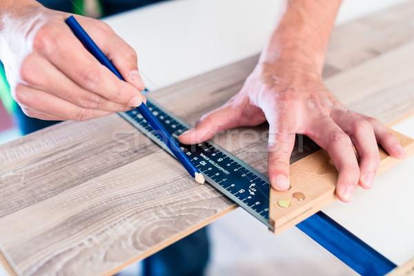 Carpenter marking cut on parquet piece  Stock photo © Kzenon