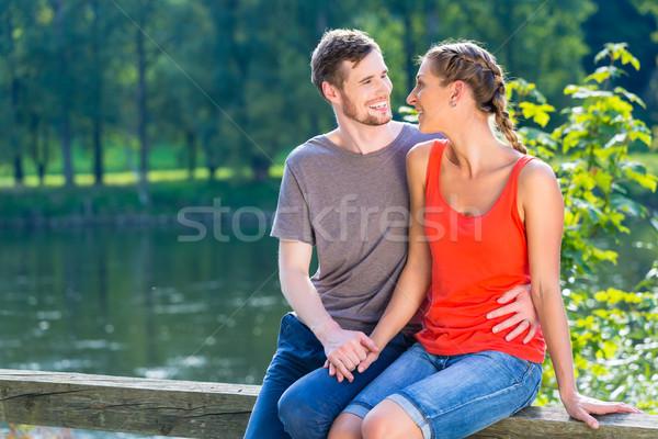 Pár ül folyópart nyár Duna megnyugtató Stock fotó © Kzenon