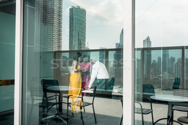 Proficient Indian business people at work in a modern office bui Stock photo © Kzenon