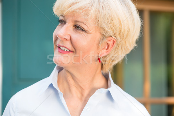 Close-up portrait of a cheerful senior woman with good health an Stock photo © Kzenon