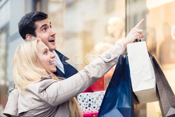 Couple at shop window doing Christmas shopping Stock photo © Kzenon