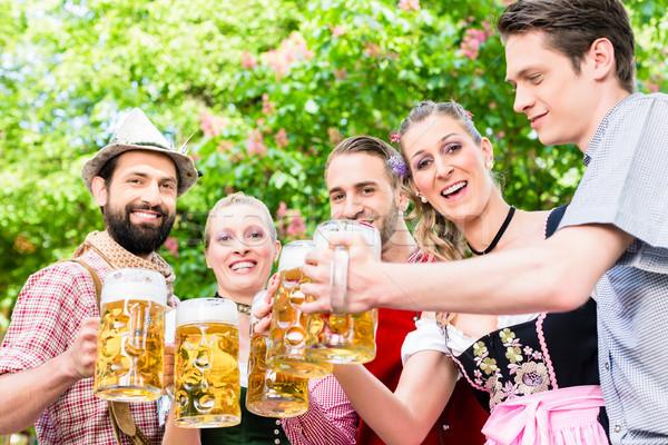 Barátok áll gesztenye pirít sör boldog Stock fotó © Kzenon