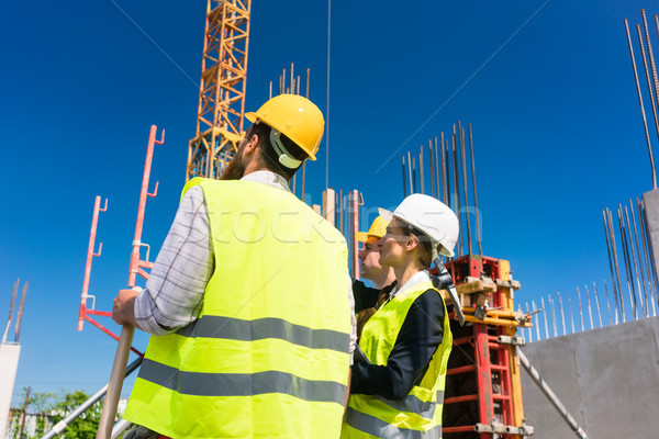 Experienced female architect or manager guiding the workers Stock photo © Kzenon