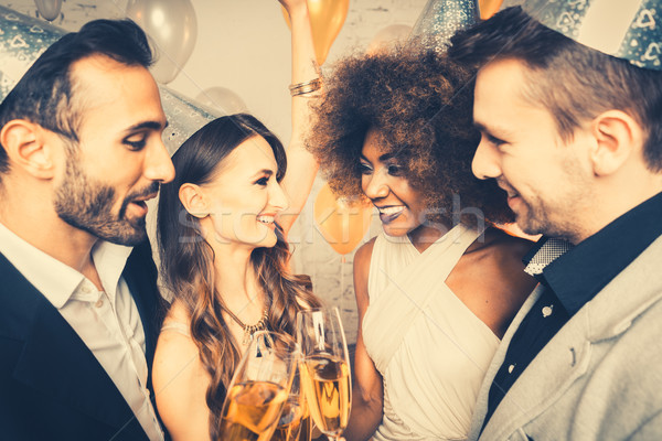 Men and women celebrating party while clinking glasses Stock photo © Kzenon