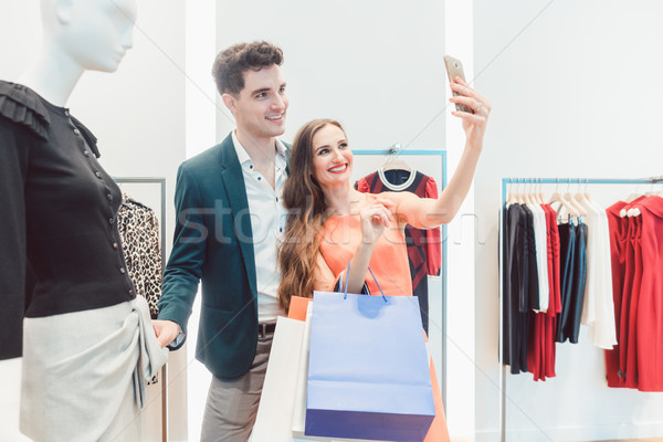 Couple doing selfie photo with their catch in fashion store Stock photo © Kzenon