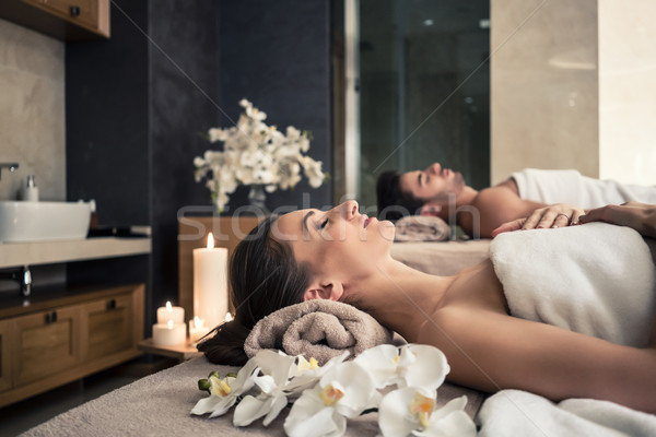 Man and woman lying down on massage beds at Asian wellness center Stock photo © Kzenon