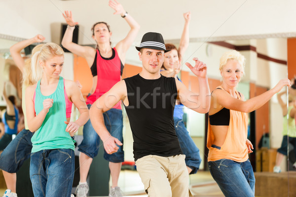 Zumba or Jazzdance - young people dancing in studio Stock photo © Kzenon