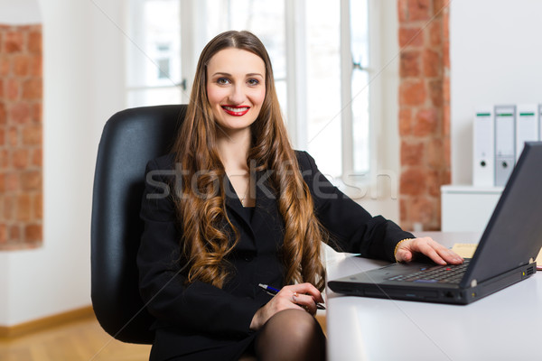 woman in office sitting on the computer Stock photo © Kzenon