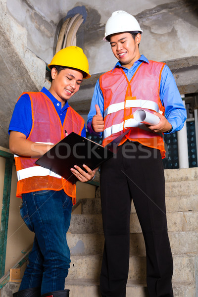 Asian supervisor and worker on building site  Stock photo © Kzenon