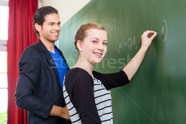 Teacher testing  student during math lessons in school Stock photo © Kzenon