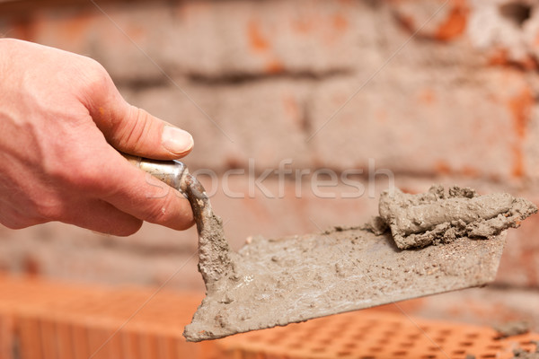 Bricklayer working on construction site Stock photo © Kzenon