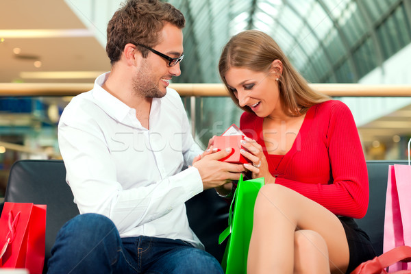 Stock photo: Man with gift for woman in mall