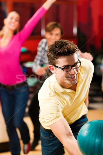 Friends bowling having fun Stock photo © Kzenon