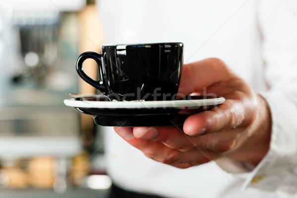 Coffeeshop - barista presents coffee or cappuccino Stock photo © Kzenon