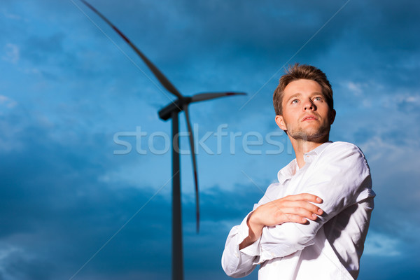 Man in front of windmill and sky Stock photo © Kzenon