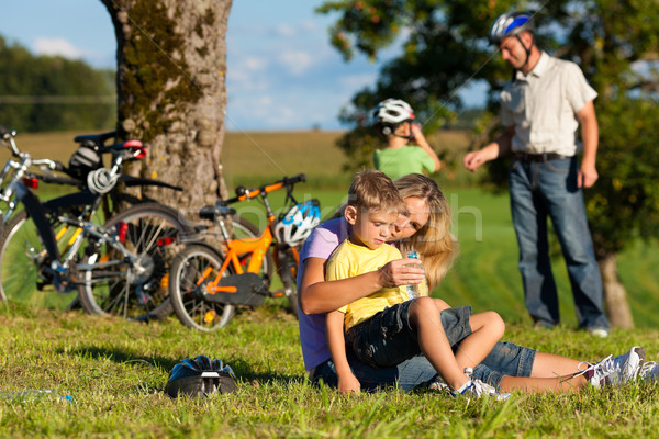 Stock photo: Family on getaway with bikes