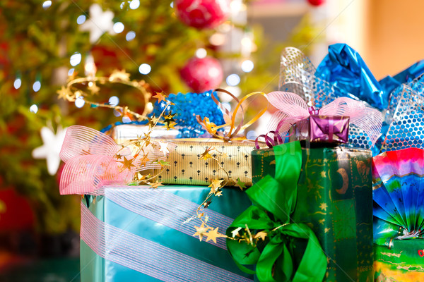 Christmas gifts under x-mas tree Stock photo © Kzenon