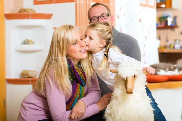 Famille rocker cheval parents fille jouer Photo stock © Kzenon