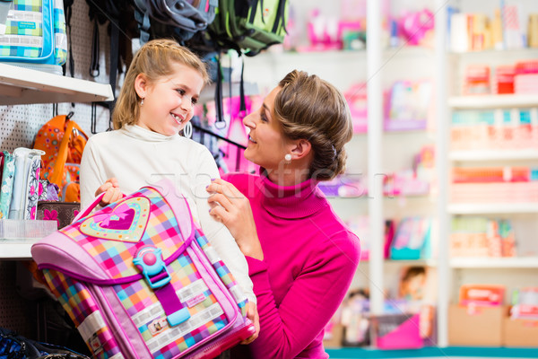 Mother and kid buying school satchel or bag in store Stock photo © Kzenon