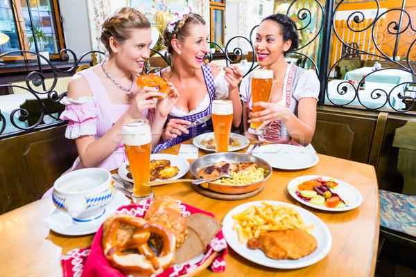 Nők eszik ebéd étterem három vacsora Stock fotó © Kzenon