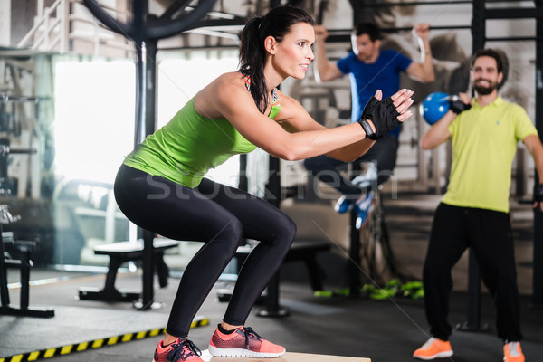 Stock photo: Group of men and woman in functional training gym