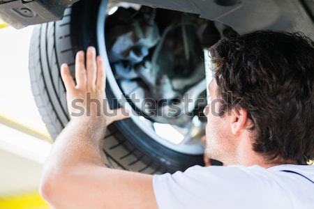 Father and son checking trunk of new car in dealer showroom Stock photo © Kzenon