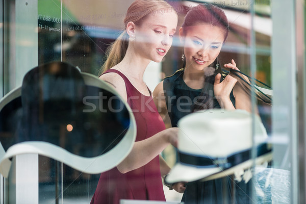 Two pretty young women window shopping Stock photo © Kzenon