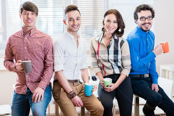 Equipe jovem criador pessoas de negócios escritório uma mulher Foto stock © Kzenon