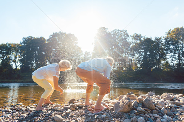 Two senior people enjoying retirement and simplicity while throw Stock photo © Kzenon
