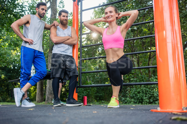 Beautiful young woman smiling while doing Bulgarian squats durin Stock photo © Kzenon