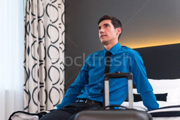 Man arriving in hotel room Stock photo © Kzenon