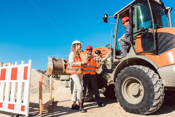 Stock photo: Civil engineer and worker discussion on road construction site