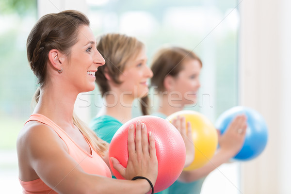 Young women doing  yoga during postnatal recovery lesson Stock photo © Kzenon