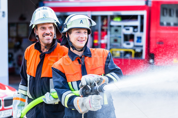 Stock photo: Men of the fire department extinguish fire