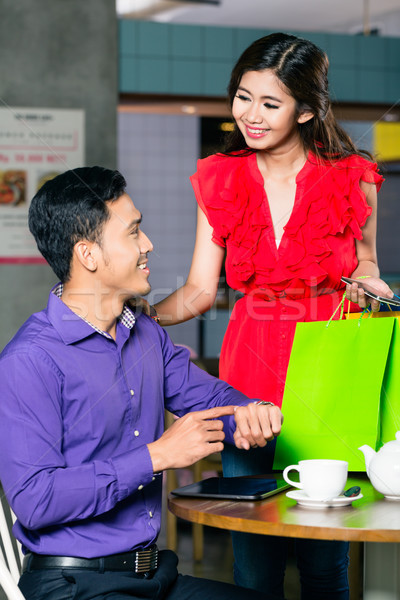 Happy young man waiting for his beautiful girlfriend to come after Stock photo © Kzenon