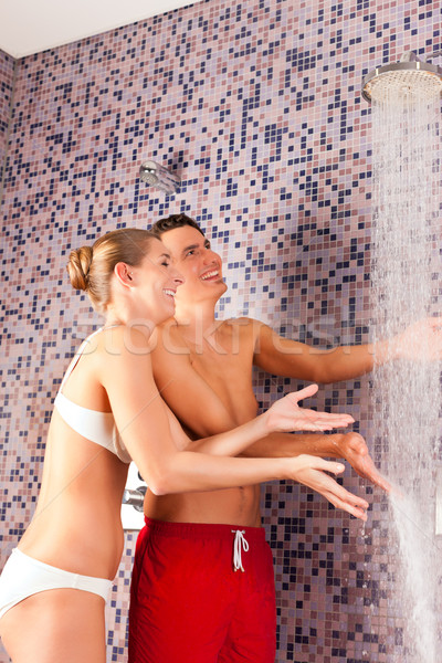 Young couple under experience shower Stock photo © Kzenon