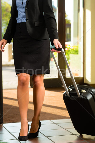 Businesswoman arriving at Hotel Stock photo © Kzenon