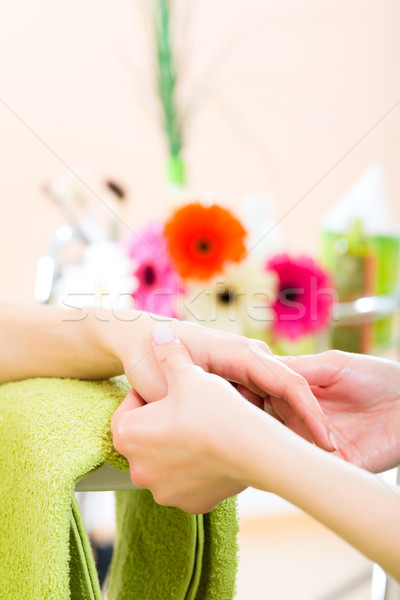 Woman in nail salon receiving hand massage Stock photo © Kzenon