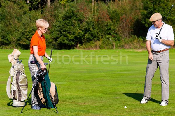 Mature couple playing golf Stock photo © Kzenon
