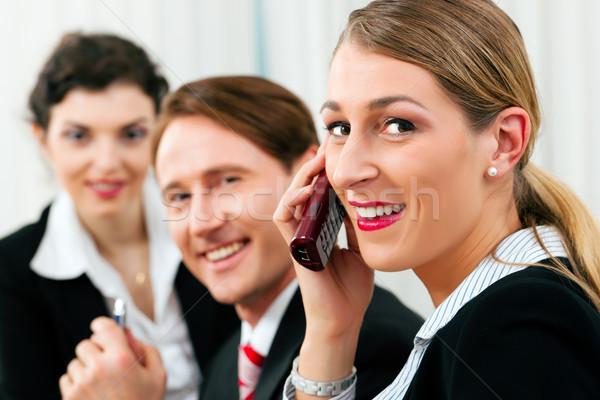 бизнес-команды рабочих служба малый бизнес команда телефонов Сток-фото © Kzenon