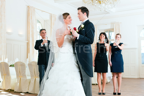 Bridal couple clinking glasses Stock photo © Kzenon