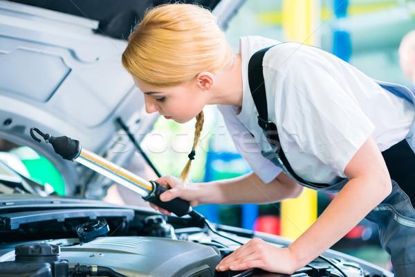 Female mechanic working in car workshop Stock photo © Kzenon