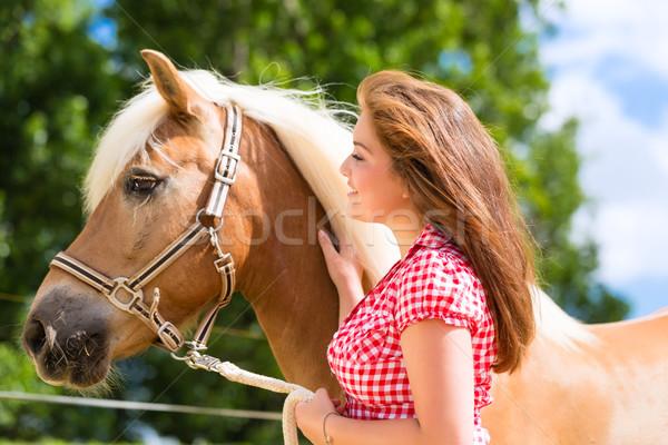 Woman petting horse on pony farm Stock photo © Kzenon