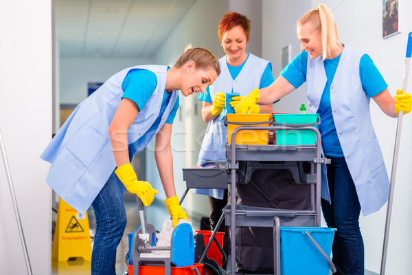 Team of cleaning ladies working Stock photo © Kzenon